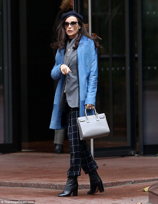 City sophisticate: Demi Moore cut a striking figure in a cornflower-blue coat and navy plaid trousers while filming scenes for her new film Blind in NYC on Thursday