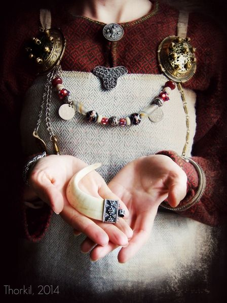 Viking woman jewelry, beads, oval broochesand boar tusk