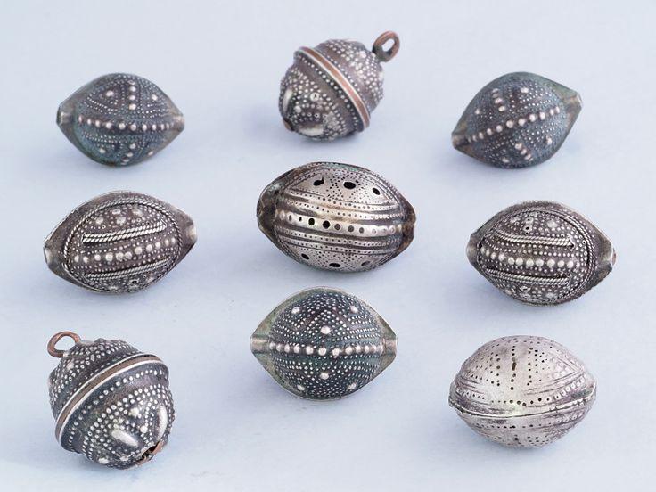"Antique silver ""agrab al fadda"" beads from Mauritania."