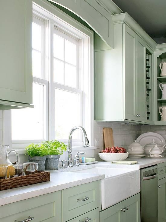 Sea foam green painted cabinets White subway tile backsplash Carrera