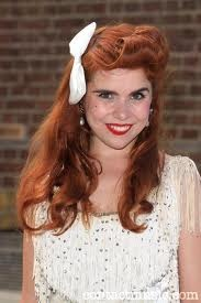 Paloma Faith.  I'm sure there are people out there who are huge fans of Paloma the singer.  I think that she's an OK singer (my age rather than her voice) but I'm a huge fan of the Paloma who has come out and says she's ADHD.  What a fantastic role model, what a great achiever.  YO, go Paloma!   http://en.wikipedia.org/wiki/Paloma_Faith