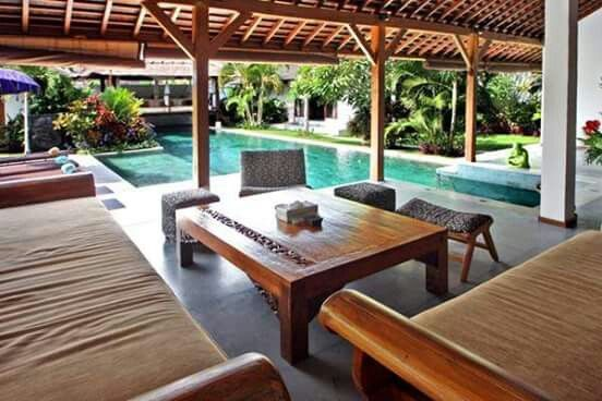 """Villa B Bali was built in #wooden architecture inspired by antique #Joglo the island of #Java , with impressive solid teak beams that form high ceilings and provide a feeling of fullness , and shingled roofs wood called """" #Sirap """" that form #beautiful asymmetrical lines . These combined with a search for more contemporary lines and #luxurious furnishings local materials give the villa an undeniable charm B at the crossroads of #Balinese tropical living and modern comforts of #luxury villas…"""