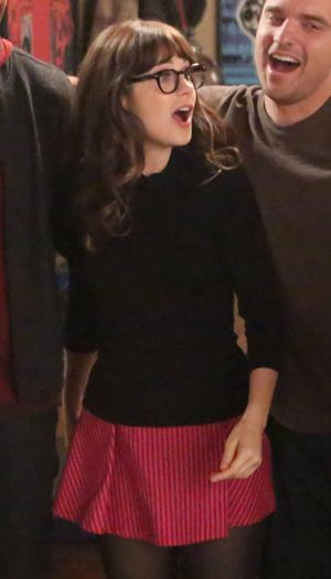 Zooey Deschanel's Pink striped skirt and black bow sweater on New Girl.  Outfit Details: http://wwzdw.com/z/4469/ #WWZDW