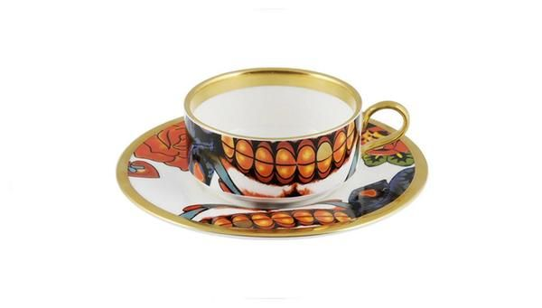 Delicate 'Inkhead' Mocha Cup & Saucer featuring 22kt gold tooth and hand gilding. Taking inspiration from tattoos and edgy art, 'Inkhead' features a vibrant and bold skull design full of colour and detail. Made in Stoke-on-Trent, England. Fine Bone China. Find out more here: https://thenewenglish.co.uk/collections/inkhead #TheNewEnglish #Inkhead #Tattoos