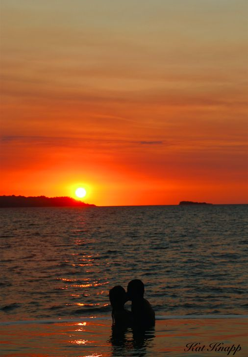 A sunset infinity pool kiss in Madagascar.
