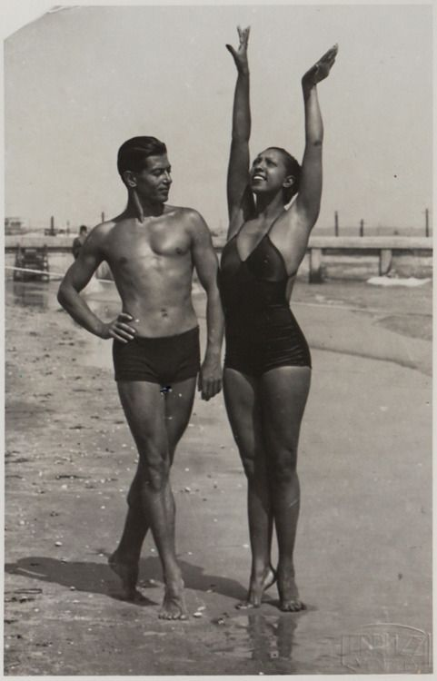 Josephine Baker and the legendary Russian ballet dancer Serge Lifar on the beach, probably somewhere in France. Very probably in the early 1930s. Photo: Hôtel des Ventes, Genève