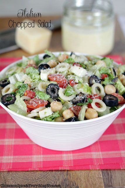 Italian Chopped Salad- A BIG chopped salad loaded with salami, mozzarella, artichoke hearts, chickpeas, cucumber, plum tomatoes, red onion, little pasta rings and romaine lettuce tossed in a tangy Parmesan vinaigrette. Leave out the romaine and it makes a killer pasta salad, both absolutely delicious!