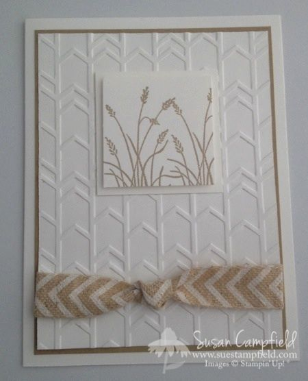 """By Susan Campfield. Dry emboss a white cardstock panel in the """"Arrows"""" embossing folder (Stampin' Up). Stamp the grass from """"Wetlands"""" (Stampin' Up) in Crumb Cake ink. Pop up on a white mat; then attach to the dry embossed panel. Wrap Natural 5/8"""" Chevron Ribbon (Stampin' Up) around the piece before attaching to Crumb Cake mat & then a white card base. Quick card but oh, so lovely!"""