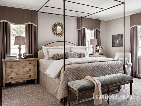 An antique bench covered in embroidered velvet sits at the foot of an airy canopy bed softened with a fabric headboard and luxe linens. - Photo: Emily Jenkins Followill / Design: Courtney Giles