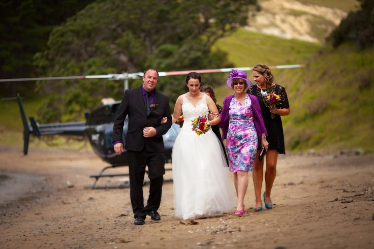 Helicopter arrival for the Bridal party at Whangaihe bay wedding with Susi Liddington Creative. www.susiliddington.com www.jennayoungphotography.co.nz