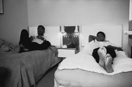 GREAT BRITAIN. London. 1966. World heavyweight champion Muhammad ALI with his brother Rachomon in their London hotel room prior to a fight.