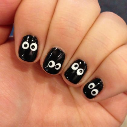 Halloween Nail Art: Spooky Night Time Eyes... would be cool with glow-in-the-dark polish for the eyes.