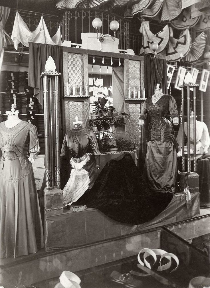 1909. Stunning Edwardian dresses, inside view of a shop, atelier, workplace.