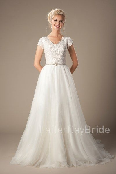 modest wedding dresses |  Markova | LatterDayBride | Worldwide Shipping This stunning modest bridal gown features a unique lace complimented by a lovely scalloped neckline with a beaded natural waistline and a flowy A-line skirt.  Gown available in Ivory or Antique/Ivory   *Gown pictured in Antique/Ivory