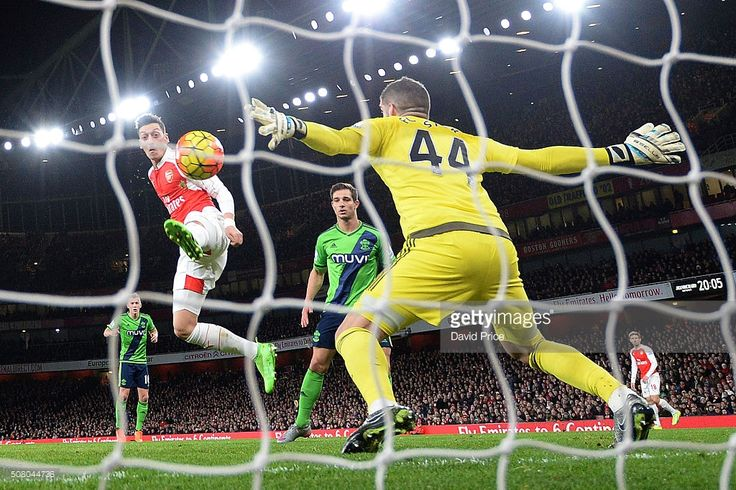 Mesut Ozil of Arsenal has his shot saved Fraser Forster of Southampton during the Barclays Premier League match between Arsenal and Southampton at Emirates Stadium on February 2, 2016 in London, England.