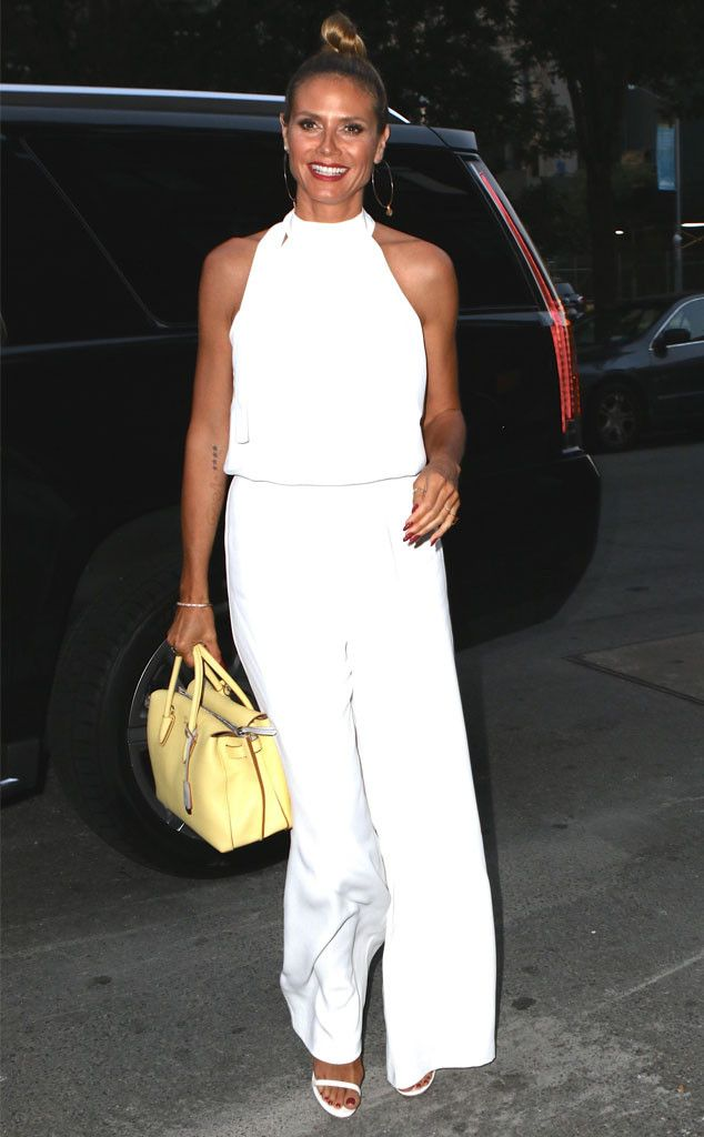 Heidi Klum from The Big Picture: Today's Hot Pics  Bronzed babe! The fashion icon shows off her summer glow in an all white jumpsuit in NYC.