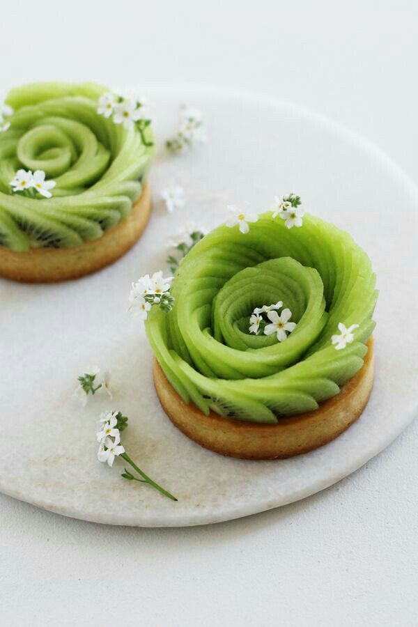 kiwi slices, probably set in ganache on pastry base (photo only)