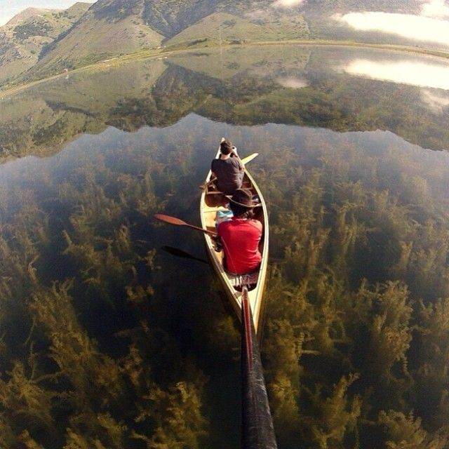 Canoeing the a Crystal Clear Lake, Italy   Photography by ©Cristian Perrella / Go pro #Padgram