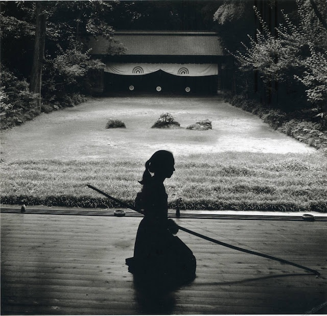 """""""In Kyudo philosophy, you don't aim--you become one with the target. Then, in fact, there's nothing to aim at. I find it works well with women, too. Give it a try.""""  Japanese archery -Kyudo- : photo by Linda Butler from Rural Japan"""