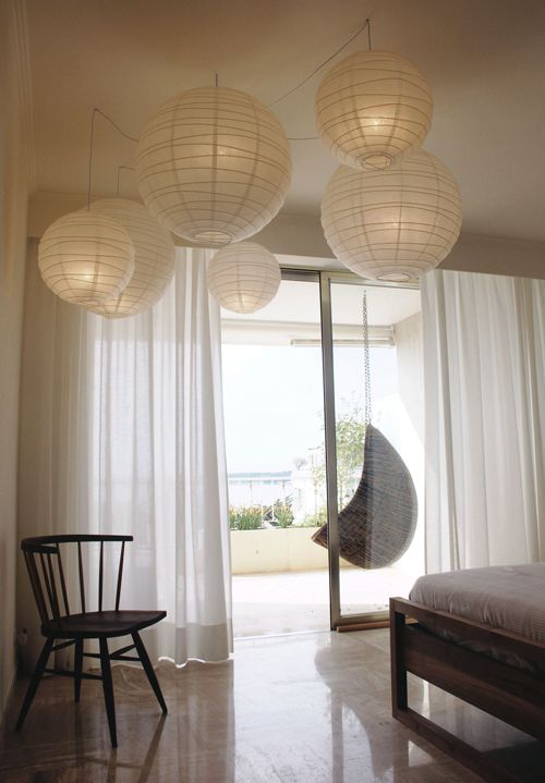 A fresh and seaside like house in Cannes by Nomade Architettura http://www.nomadearchitettura.com/#all  bedroom, hanging paper lamps, hanging chair