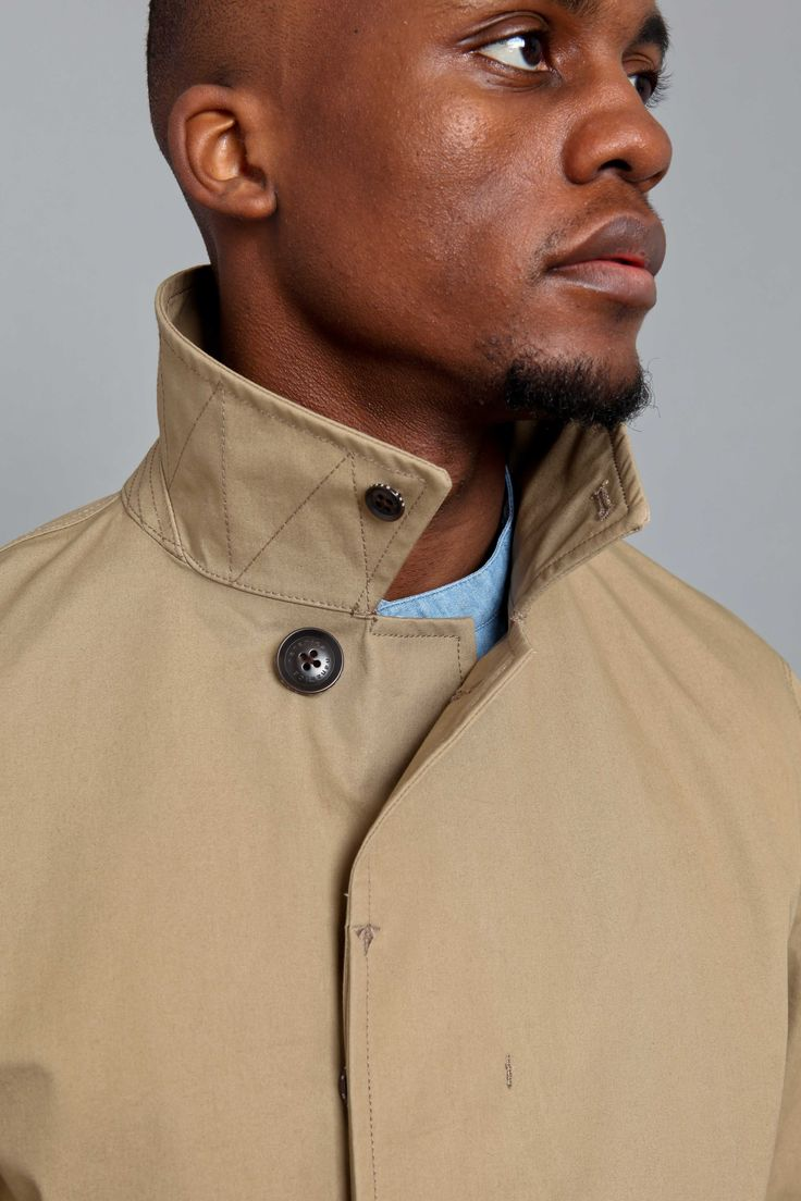 Nanamica GORETEX Soutien Collar Coat Beige is crafted from resistant waterproof fabric. Here is a refined trench coat with technical abilities for action.