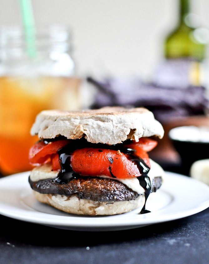 Asiago portobello burgers with red peppers & balsamic glaze ... that about says it all ... except she puts it on an English muffins (with those nooks & crannies) ... genius. From How Sweet It Is