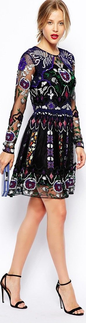 Embroidered folk pattern party dress - article about folkwear