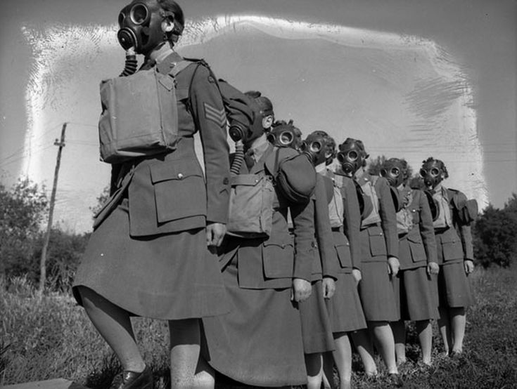 Personnel entering a gas chamber during a training exercise, No.2 Canadian Women's Army Corps, Basic Training Centre, Vermilion, Alberta, Canada, July 1943.