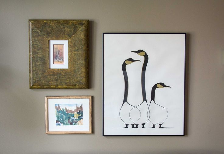 Native art in a group of three hanging on wall