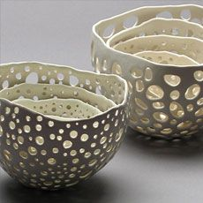 Kate Tremel. Imagine these in raku, with alternating reduced with bio material and removed pieces.