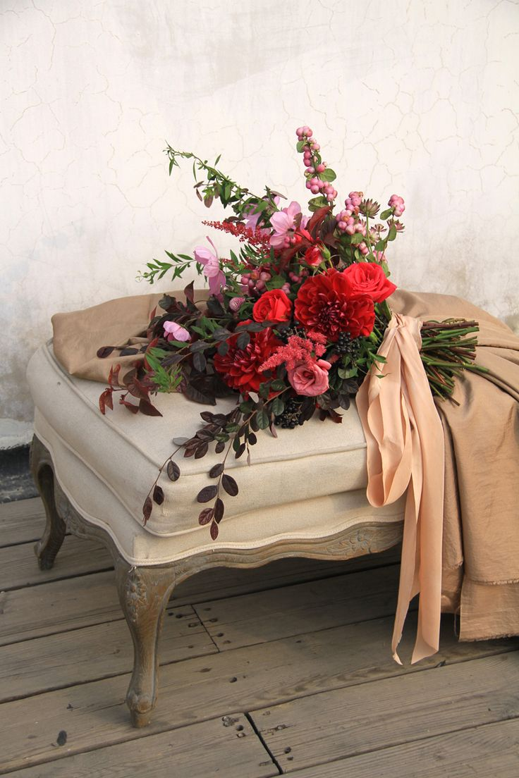 pink and red wedding bouquet by sarah winward