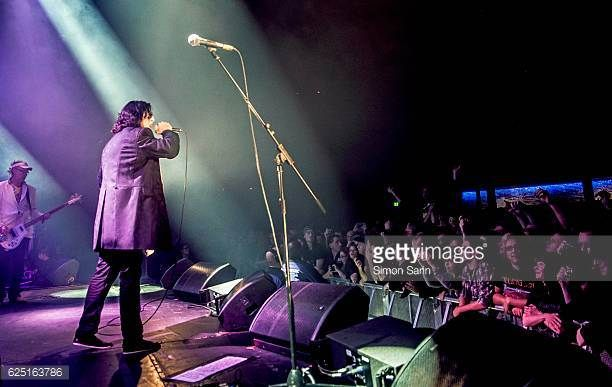 A view from the side of the stage showing the crowd watching Jaz Coleman of Killing Joke performing at The Roundhouse Camden London on 6th November...