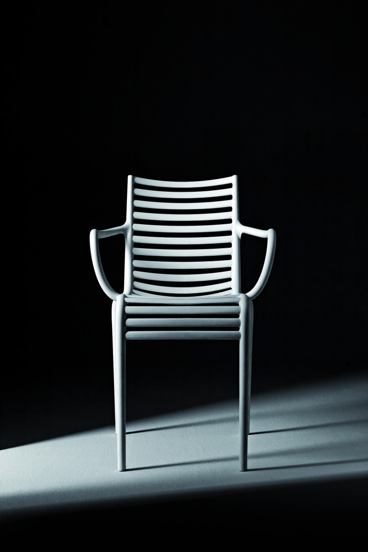 PIP-e By Philippe Starck  Stackable chair and armchair. White, yellow, orange or grey polypropylene monobloc.