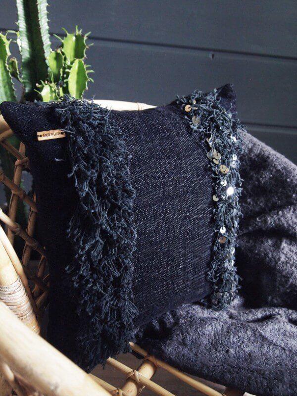 Handwoven Handira pillow with fringe and metal sequin details.