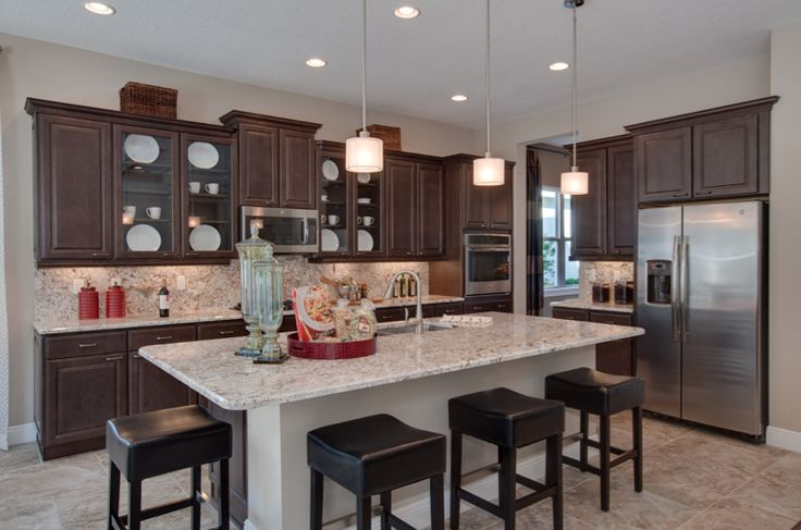 Great Ways For Lighting A Kitchen: A Large Kitchen Island Is The Perfect Way To Invite Guests