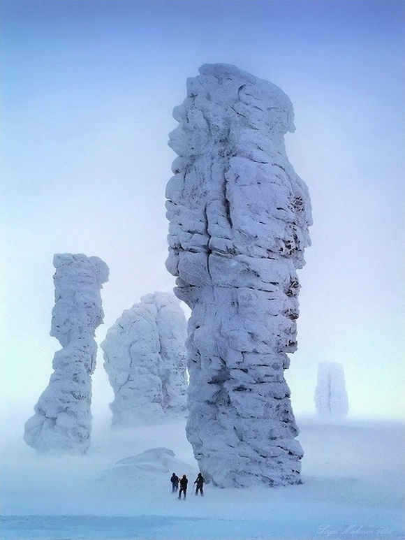 Rocks?  They look like calcified lumbering giants, whereas the humans look dwarfed and utterly insignifcant ... - The Manpupuner rock formations, Ural mountains in Komi Republic