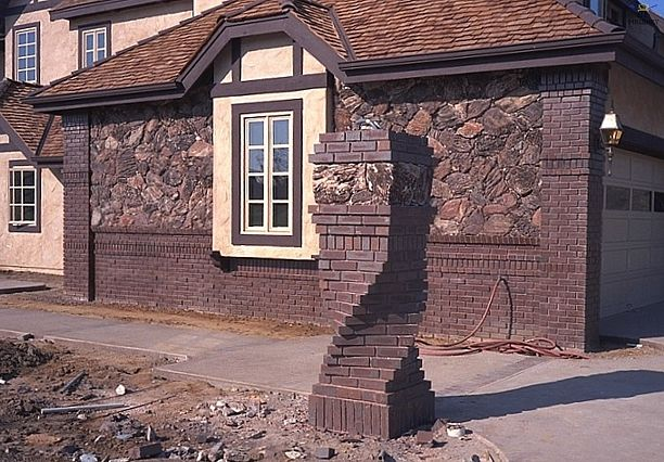 Brick and stone pillar idea for driveway entrance
