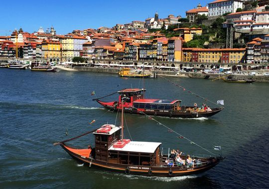 Wish I Was There: A Taste of Porto - via Mongomery Advertiser 18.06.2015   I love to submerge into the sounds and smells and flavors of the places I visit. The language, the music, the smell and taste of the local food... even the sun and wind feel different in different parts of the world. #porto #portugal #travel #foodie Photo: Boats on the river Douro in Porto.