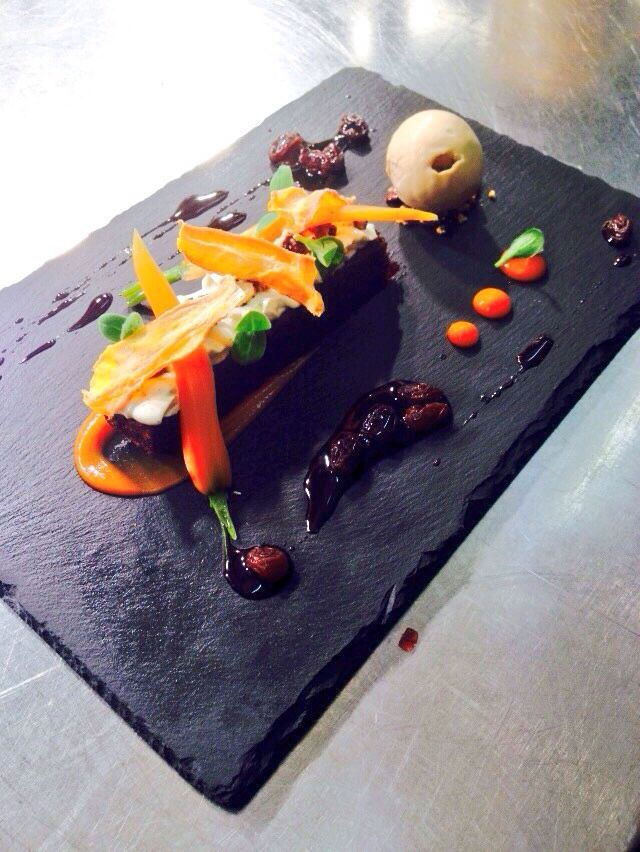 Carrot cake with walnut ice cream, verjus, confit baby carrot, carrot purée and candied walnut.