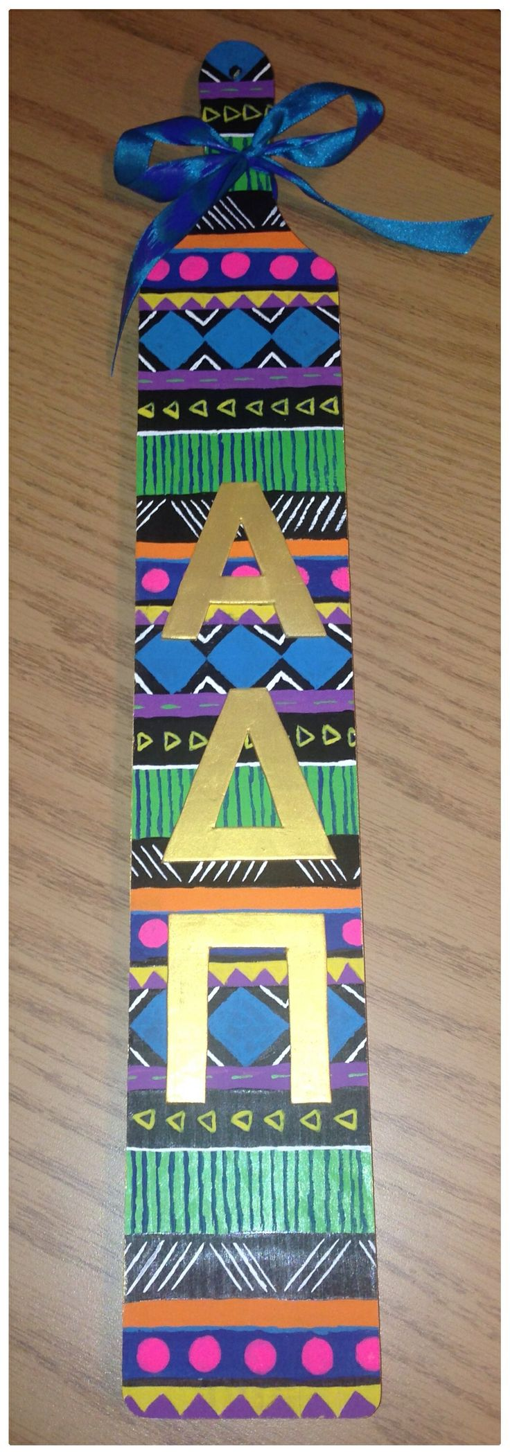 I don't like the shape of this paddle at all but I love the pattern, and it need more on it like big and little, names, pledge class, crest, etc.