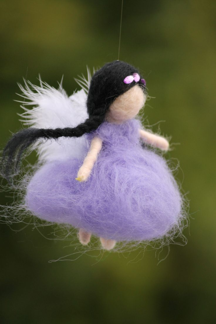 Purple needle felted fairy with feather wings.