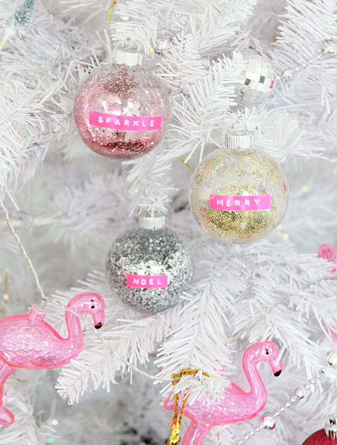 I love creating new Christmas ornaments every year, they are such a blank canvas to add any kind of design you like! I used my retro label maker and that was not enough- and I decided to add glitter as well! Isnt everything better with glitter Christmas Photo Props, Easy Christmas Ornaments, Decoration Christmas, Glitter Ornaments, Xmas Decorations, Christmas Bulbs, Christmas Crafts, Diy Ornaments, Beaded Ornaments