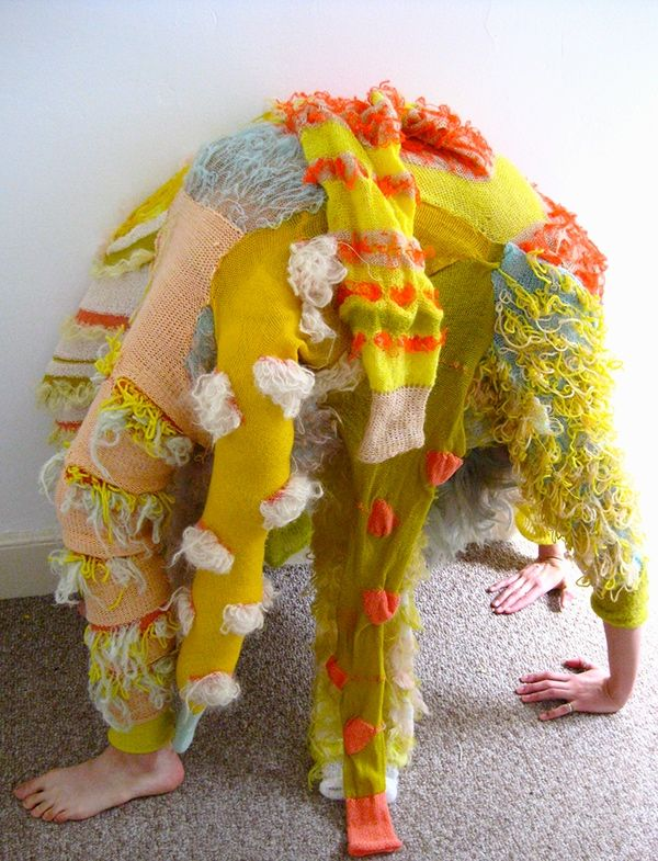 """Inspired by Bacteria, I created a costume of several legs, utilizing different machine knit techniques."""