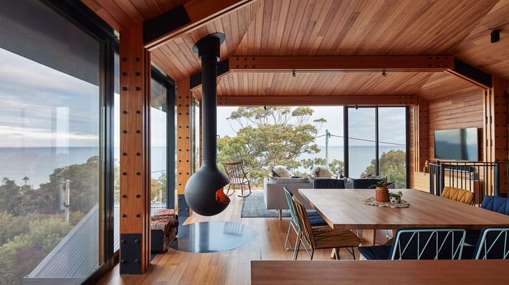 """Fed up with all the """"McMansions"""" springing up along Australia's Great Ocean Road, Austin Maynard Architects has restored an old beach shack and built a second, elevated building alongside it."""