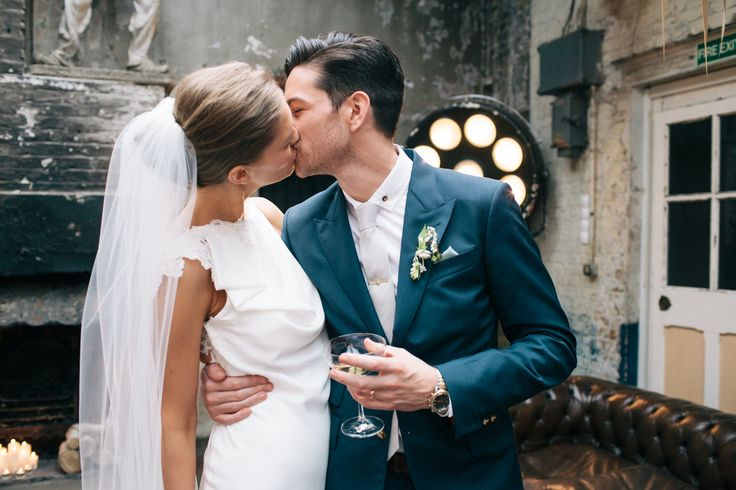 David Fielden Wedding Dress & Jimmy Choo Shoes for an urban, industrial wedding at MC Motors London City with pastel bridesmaid gowns & Groom in a Vivienne Westwood Suit. | Rock My Wedding