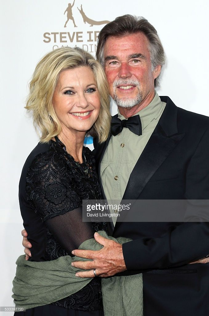 Singer Olivia Newton-John (L) and husband John Easterling attend the Steve Irwin Gala Dinner at JW Marriott Los Angeles at L.A. LIVE on May 21, 2016 in Los Angeles, California.  (Photo by David Livingston/Getty Images)