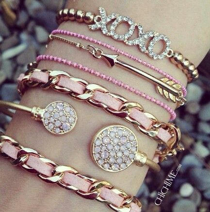 Arm candy stack of bracelets for spring and summer in gold, pink