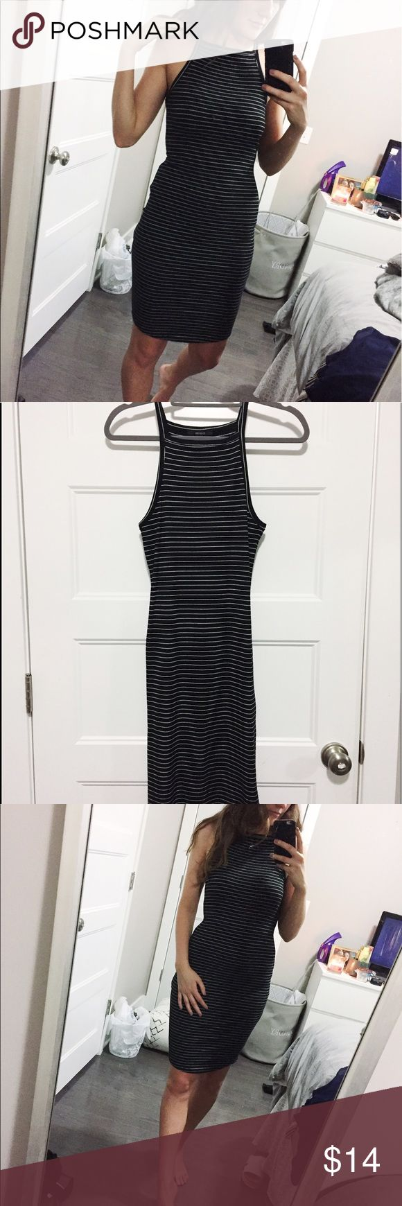 Knit going out dress Black and white stripped knit midi dress. Flattering neckline, perfect for a night out. Forever 21 Dresses Midi