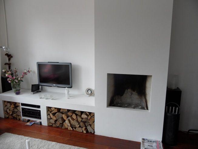 Schouw loopt door in tv-meubel/ houtopslag in een tint, zonder plint
