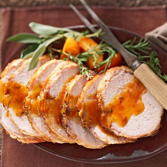 Upgrade your weeknight dinner with this tender, succulent pork roast draped in a golden herbed fruit sauce. This easy slow cooker recipe is great for indulging on special occasions, too -- it's low in calories, fat, and sodium.